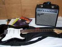 For sale Beginner electric guitar with amp. books gig