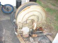 for sale is a elect hose reel works good great for lawn