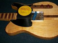 This solid body Tele style electric guitar has U.S.A.
