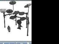Drumset includes set, amp, wiring, stool, drum sticks