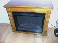 Semi new electric fireplace we used it only once and it
