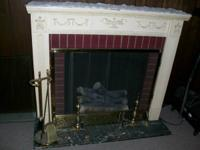 For Sale: Antique Electric Fireplace. Does not put out