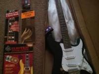 Electric guitar w/strap - still new in box - never been