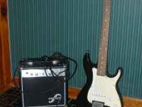 Kay brand Electric Guitar black and white with a