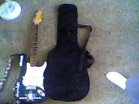 selling my beautiful teal electric guitar. need to sell