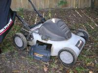 Electric lawn mower. Used but works great. Side