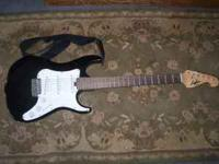 HERE IS A NICE USED ELECTRIC GUITAR MADE BY G.W. LYON