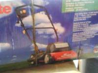 Homelite 18in electric mower....new in box. email or