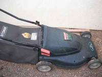 Electric mower with bag. Call Melissa . Location: