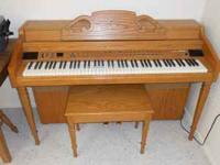 Electric Piano / Organ. Comes in a thick solid oak
