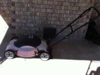 Lawn Hog Electric Push Mower, works good.  Location:
