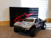 I am offering 4 of my electric 1/8 scale offroad