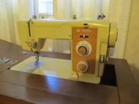 Electric Sewing Machine, Penncrest cabinet model, has