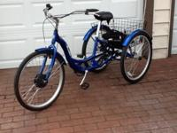 "Schwinn Meredian battery powered tricycle. 26"" front"