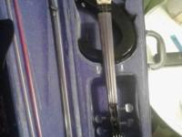 Electric violin. Missing one string but comes with two