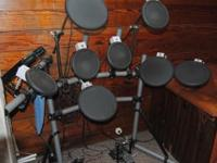 this is a very nice larger Yamaha Electronic Drum Set.