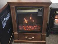 ELECTRICAL FIRE PLACE IN EXCELLENT HEALTH CONDITION.
