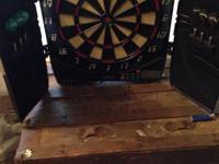 Electronic Dart Board includes darts, extra plastic