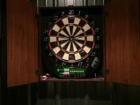 8 player/24games. Electronic dart board in a real wood