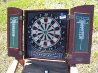 Nice electronic dart board in wood case...please email