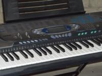 Casio Electronic Keyboard with stand and charger.