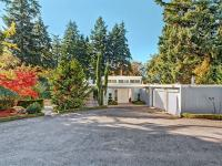 Contemporary one level living on shy 1/2 acre parcel.