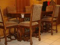 Sophisticated mint condition! With 6 chairs, this table