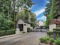 Nestled in a secure gated community with a stream and