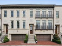 Elegant gated brick townhome with custom mill work