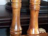 This is an elegant set of a wooden salt shaker and