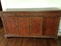 Elegant wood media cabinet.  Has spanish-influenced