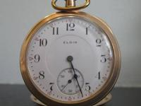 This is an antique Elgin pocket watch. Based on its