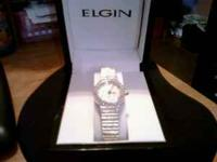 This Elgin Silver Crystal Watch is like brand new. It