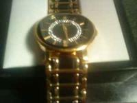 Mens Gold/Black Elgin watch. Like new