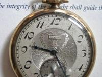 A very nice open faced Elgin pocket watch. A beautiful