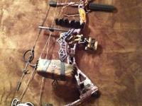 4 pin sight, G5 5 arrow quiver, 6 gold tip ted nugent