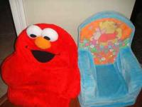 The Elmo chair giggles and shakes when someone sits in