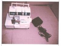 ELNITE SERGER L3 SEWING MACHINE USED SOME FLAWES BUT