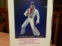This is a lovely 21 inch tall Elvis doll. He is in his