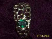This is a 1 carat emerald set in sterling silver. The