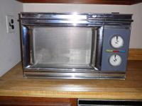Emerson Black 0.9-Cubic Foot Countertop Microwave Used