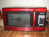 Emerson Microwave.Red in color.New components MW8999RD.