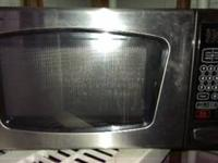 Microwave oven by Emerson.  Great Condition.