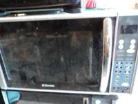 Larger size Microwave Oven by Emerson Control touch