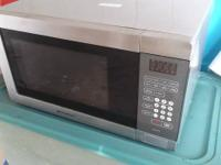 Emerson 1.5 cu. Ft. Microwave.  Has a digital clock and