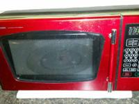 Great little red Emerson microwave. Absolutely nothing