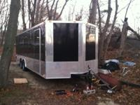 like new condition enclosed car trailer with windows.