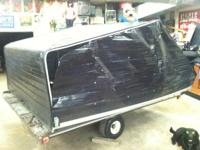 Enclosed snowmobile trailer top.   Bought it but it