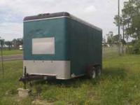 TRAILER WITH ROLL DOWN REAR DOOR, THE SPRINGS NEED SOME