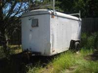 enclosed utility trailer, has some rust and some dents,